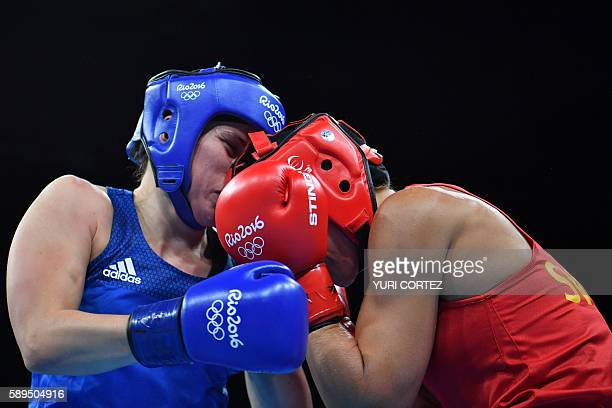 Sweden's Anna Laurell Nash fights Great Britain's Savannah Marshall during the Women's Middle match at the Rio 2016 Olympic Games at the Riocentro...