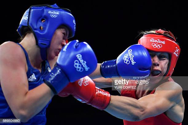 Sweden's Anna Laurell Nash punches Great Britain's Savannah Marshall during the Women's Middle match at the Rio 2016 Olympic Games at the Riocentro...