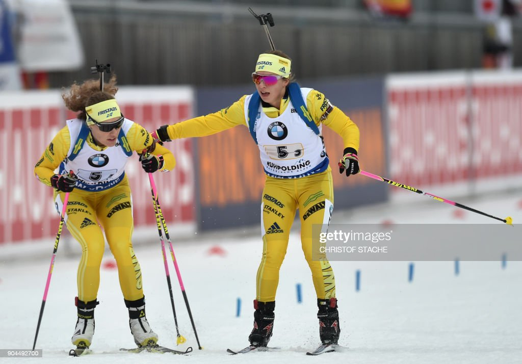 Sweden's Anna Magnusson (R) and Hanna Oeberg competes during the women's 4 x 6 km relay event of the Biathlon World Cup on January 13, 2018 in Ruhpolding, southern Germany. Germany won the event ahead of Italy (2nd) and Sewden (3rd). /