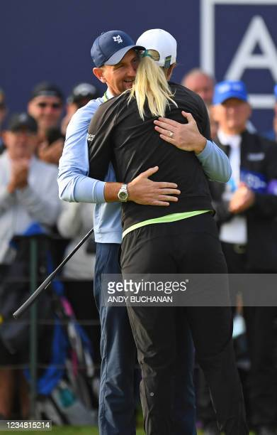 Sweden's Anna Nordqvist embraces her husband Kevin McAlpine on the 18th green after her victory in the Women's British Open, after her final round 69...