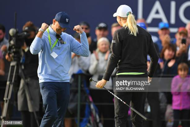 Sweden's Anna Nordqvist is congratulated by her husband Kevin McAlpine on the 18th green after her victory in the Women's British Open, after her...