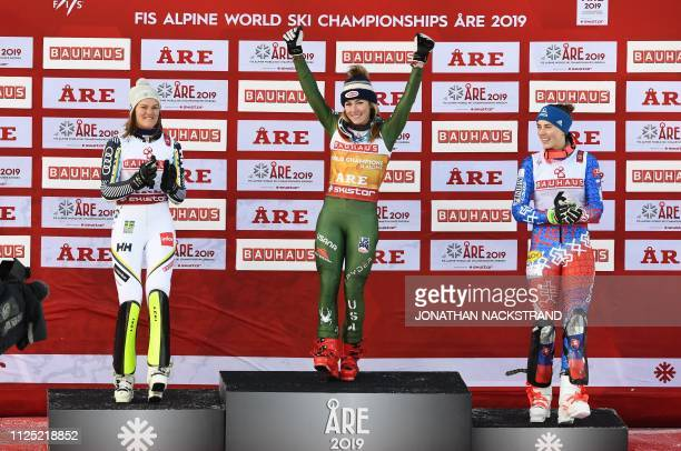 Sweden's Anna Swenn Larsson US' Mikaela Shiffrin and Slovakia's Petra Vlhova celebrate during the flower ceremony of the women's slalom event at the...