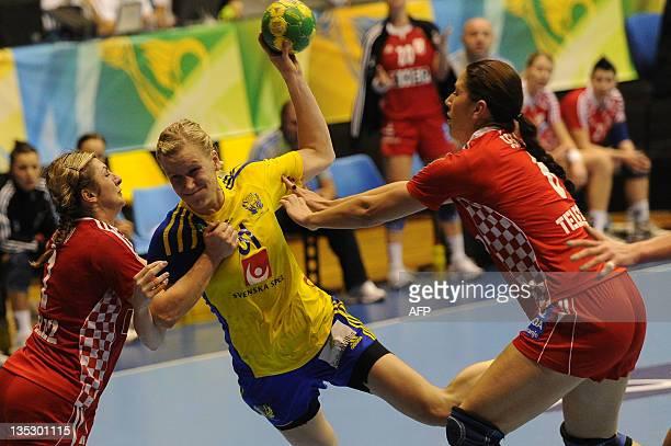 Sweden's Anna-Maria Johansson shoots through Croatia's defense during their Women's World Handball Championship match in Sao Bernardo do Campo, in...