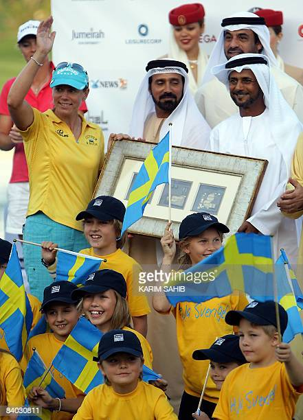Sweden's Annika Sorenstam gestures as she receives a recognition momento at the end of the Dubai Ladies Masters golf tournament on December 14, 2008....