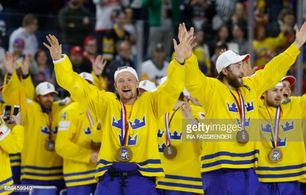 Sweden's Anton Stralman and Sweden's Victor Hedman celebrate after winning on penalties during the IIHF Men's World Championship Ice Hockey final...