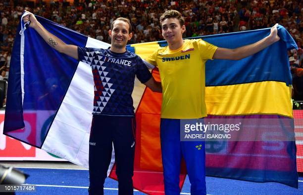 Sweden's Armand Duplantis and France's Renaud Lavillenie pose with their national flags after the men's Pole Vault final during the European...