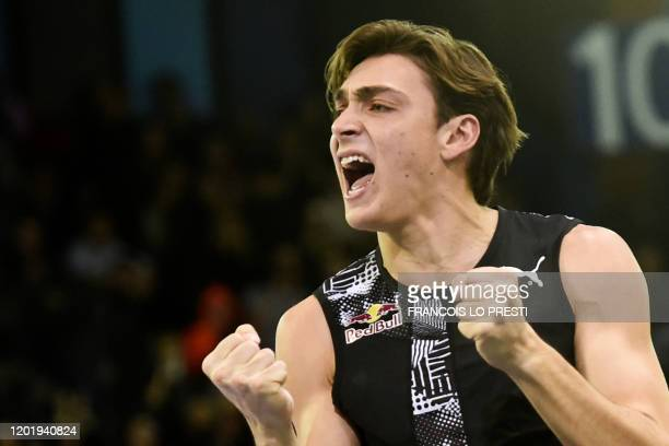 Sweden's Armand Duplantis celebrates as he competes in the Men's Pole Vault Final during the World Athletics Indoor Tour in Lievin northern France on...