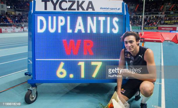 Sweden's Armand Duplantis celebrates next to the board after he broke world pole vault record of 617 metres at the Orlen Copernicus Cup 2020 World...