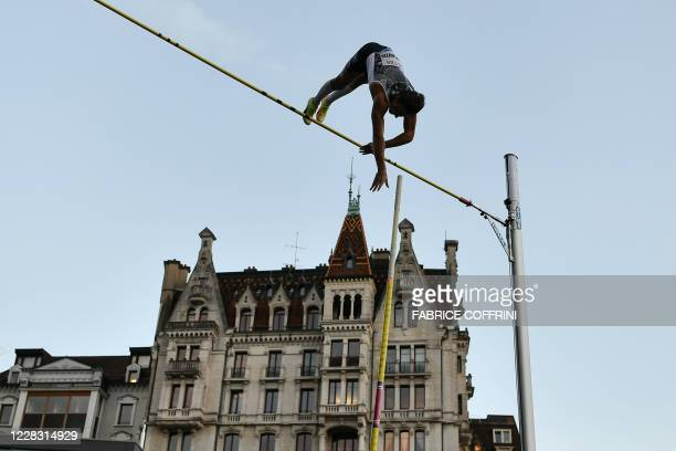 Sweden's Armand Duplantis performs during a men's pole vaulting exhibition street event of the Diamond League athletics meeting Athletissima on...