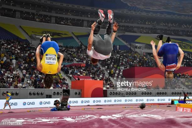 TOPSHOT Sweden's Armand Duplantis Poland's Piotr Lisek and USA's Sam Kendricks somersault after the Men's Pole Vault final at the 2019 IAAF Athletics...