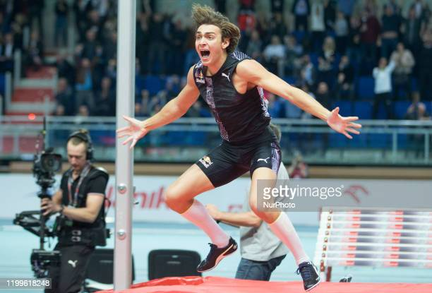 Sweden's Armand Duplantis reacts after his jump setting a world pole vault record of 617 metres at the Orlen Copernicus Cup 2020 World Athletics...