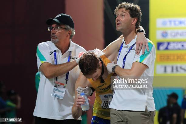 Sweden's Ato Ibanez receives medical attention in the Men's 50km Race Walk final at the 2019 IAAF World Athletics Championships in Doha on September...