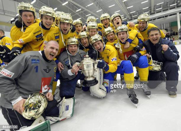 Sweden's bandy team pose with trophy and golden helmets after becoming bandy world champions 2009 beating Russia 61 in the final of the Bandy World...