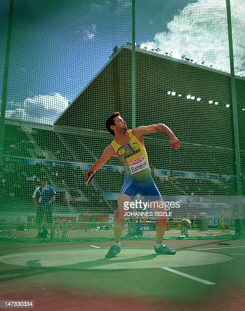 Sweden's Bjorn Barrefors competes in the men's decathlon discus throw at the 2012 European Athletics Championships at the Olympic Stadium in Helsinki...