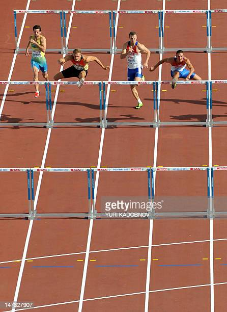 Sweden's Bjorn Barrefors Germany's Pascal Behrenbruch Russia's Artem Lukyanenko and Russia's Ilya Shkurenyov compete during the men's decathlon 110m...