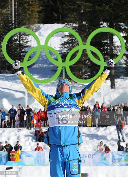 Sweden's bronze medalist Johan Olsson reacts on the podium after the men's Cross Country Skiing 30km pursuit final at the Whistler Olympic Park...