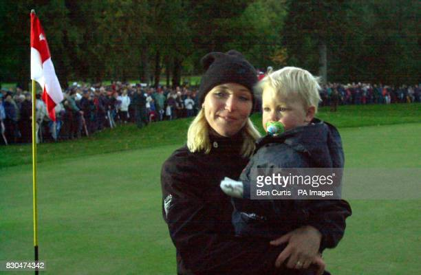 Sweden's Carin Koch holds up her son Oliver after taking the winning putt on the 17th to secure victory for Europe at the Solheim Cup in Loch Lomond