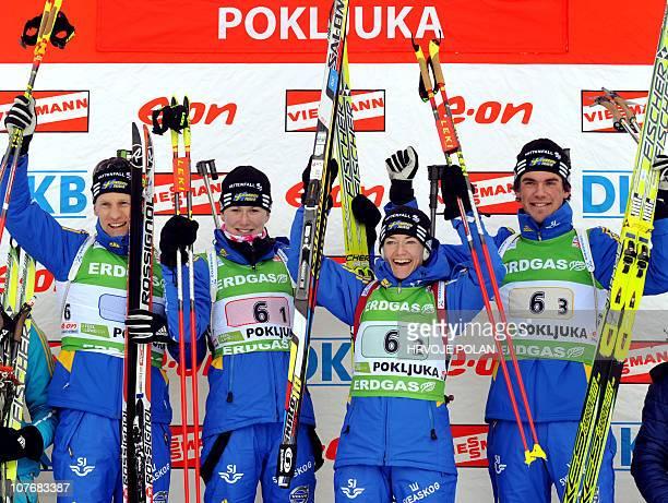 Sweden's Carl Johan Bergman Helena Ekholm Anna Karin Zidek and Fredrik Lindstrom celebrate after they won the mixed relay biathlon World Cup race in...