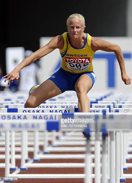 Sweden's Carolina Kluft competes during the womens heptathlon 100m hurdles 25 August 2007 at the 11th IAAF World Athletics Championships in Osaka AFP...