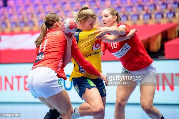Sweden's Centre back Isabelle Gullden vies with Denmark's Right back Line Haugsted and Denmark's Right back Mette Tranborg during the main round...