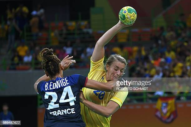 Sweden's centre back Isabelle Gullden vies with France's pivot Beatrice Edwige during the women's preliminaries Group B handball match Sweden vs...