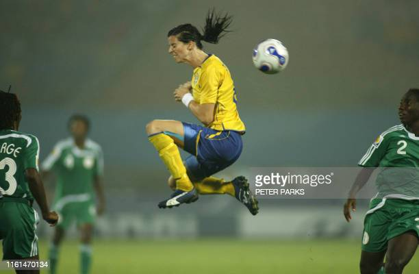 Sweden's Charlotta Schelin misses a high ball as Nigeria's Efioanwan Ekpo looks on during their group B match in the Women's World Cup 2007 in...