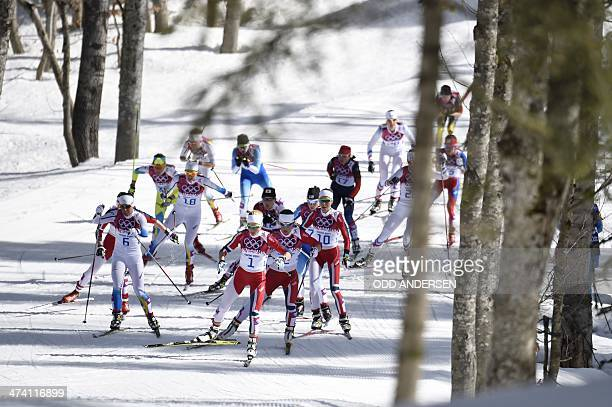 Sweden's Charlotte Kalla and Norway's Therese Johaug compete in the Women's CrossCountry Skiing 30km Mass Start Free at the Laura CrossCountry Ski...