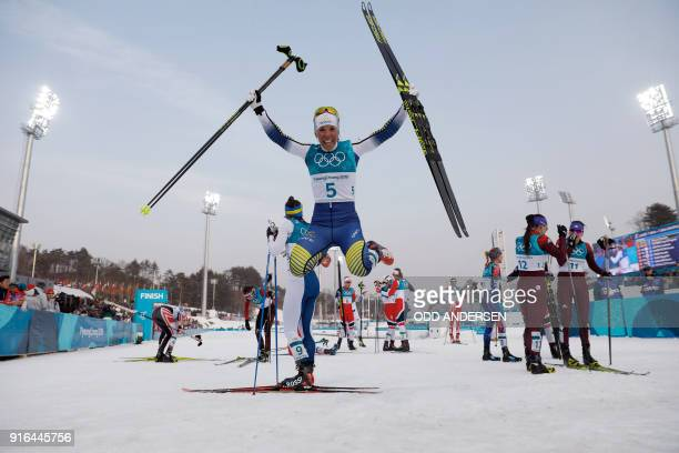 TOPSHOT Sweden's Charlotte Kalla celebrates after winning the women's 75km 75km crosscountry skiathlon event at the Alpensia cross country ski centre...