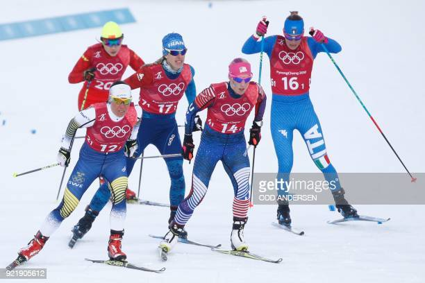 Sweden's Charlotte Kalla China's Chi Chunxue France's Aurore Jean USA's Kikkan Randall and Italy's Elisa Brocard compete during the women's cross...