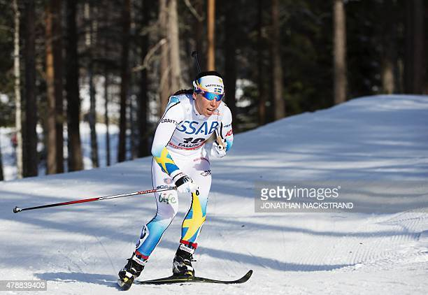Sweden's Charlotte Kalla competes during the FIS CrossCountry World Cup Ladies Skiathlon 75 classic and 75 km free competition in Falun Sweden on...