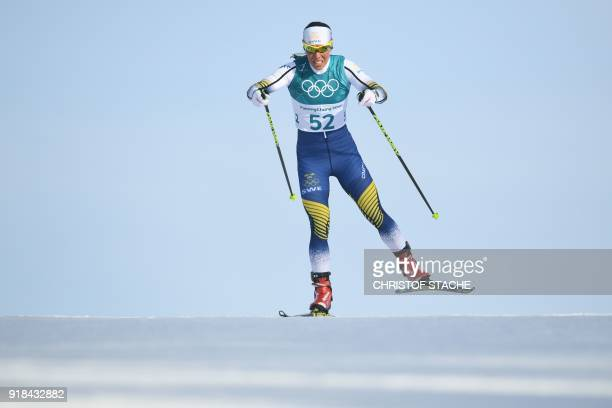 TOPSHOT Sweden's Charlotte Kalla competes during the women's 10km freestyle crosscountry competition at the Alpensia cross country ski centre during...