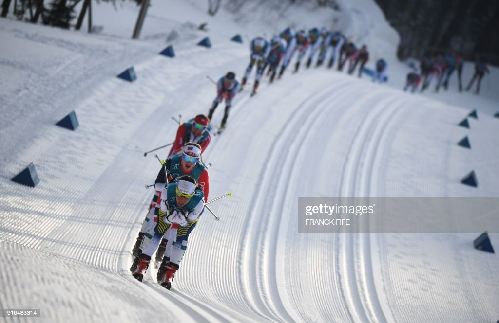 Sweden's Charlotte Kalla (front) leads the pack during the women's 7.5km + 7.5km cross-country skiathlon at the Alpensia cross country ski centre during the Pyeongchang 2018 Winter Olympic Games on February 10, 2018 in Pyeongchang. /