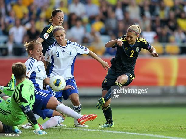 Sweden's Charlotte Rohlin tries to score past Finland's goalkeeper TinjaRiikka Korpela Anna Westerlund Tuija Hyyrynen as Sweden's Lotta Sjolin looks...