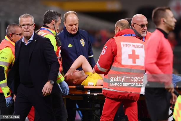Sweden's coach Jan Andersson looks on as Sweden's midfielder Jakob Johansson leaves the pitch on a stretcher during the FIFA World Cup 2018...