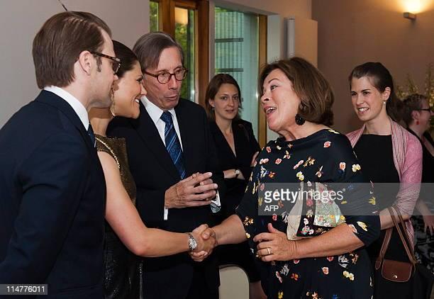 Sweden's Crown Princess Victoria and husband Prince Daniel greet German actress Rita Russek and her niece Anne Katrin Russek as Sweden's ambassador...