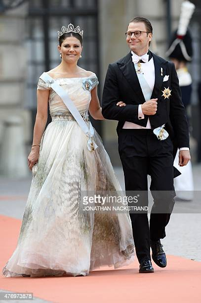 Sweden's Crown Princess Victoria and Sweden's Prince Daniel arrive for the wedding of Sweden's Crown Prince Carl Philip and Sofia Hellqvist at...