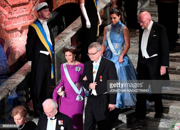 Sweden's Crown Princess Victoria and US physicist and Nobel Prize in Physics 2017 laureate Kip S Thorne Sweden's Queen Silvia and chairman of teh...