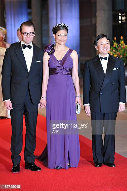 Sweden's Crown Princess Victoria her husband Prince Daniel and Japan's Crown Prince Nahurito pose on April 29 2013 as they arrive to attend a dinner...