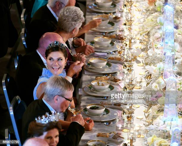Sweden's Crown Princess Victoria reacts during the 2017 Nobel Banquet for the laureates in medicine chemistry physics literature and economics in...