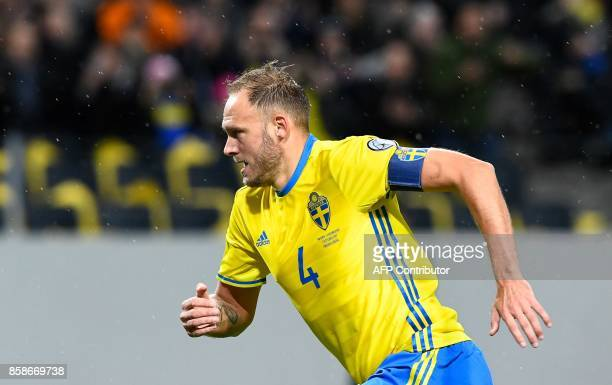 Sweden's defender and team captain Andreas Granqvist reacts after scoring during the FIFA World Cup 2018 qualifying match between Sweden and...