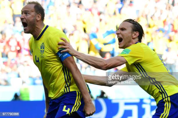 TOPSHOT Sweden's defender Andreas Granqvist celebrates after scoring a penalty during the Russia 2018 World Cup Group F football match between Sweden...