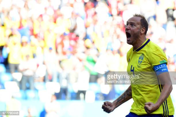 Sweden's defender Andreas Granqvist celebrates after scoring a penalty during the Russia 2018 World Cup Group F football match between Sweden and...