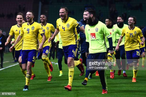 Sweden's defender Andreas Granqvist celebrates with teammates at the end of the FIFA World Cup 2018 qualification football match between Italy and...