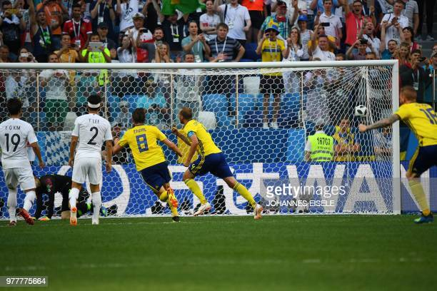 Sweden's defender Andreas Granqvist gestures after scoring a penalty during the Russia 2018 World Cup Group F football match between Sweden and South...