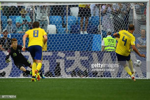 TOPSHOT Sweden's defender Andreas Granqvist shoots to score a penalty past South Korea's goalkeeper Cho Hyunwoo during the Russia 2018 World Cup...