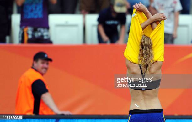 Sweden's defender Charlotte Rohlin takes off her shirt as an official watches after the Sweden vs France FIFA women's football World Cup match for...