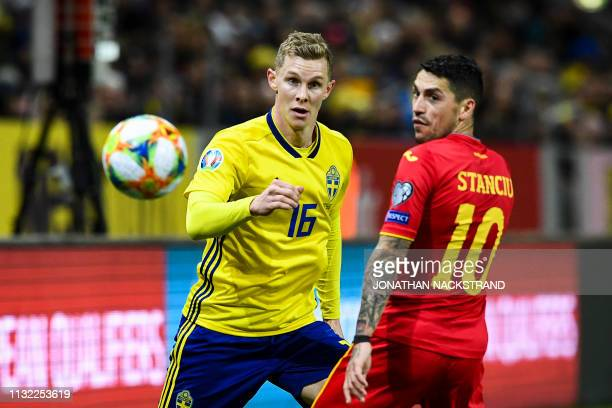 Sweden's defender Emil Krafth and Romania's midfielder Nicolae Claudiu Stanciu eye the ball during the Euro 2020 football 1st round Groupe F...