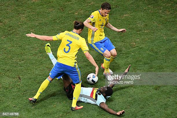 TOPSHOT Sweden's defender Erik Johansson tackles Belgium's forward Romelu Lukaku during the Euro 2016 group E football match between Sweden and...