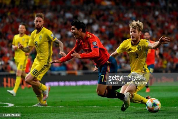 Sweden's defender Filip Helander fouls Spain's forward Alvaro Morata during the UEFA Euro 2020 group F qualifying football match between Spain and...