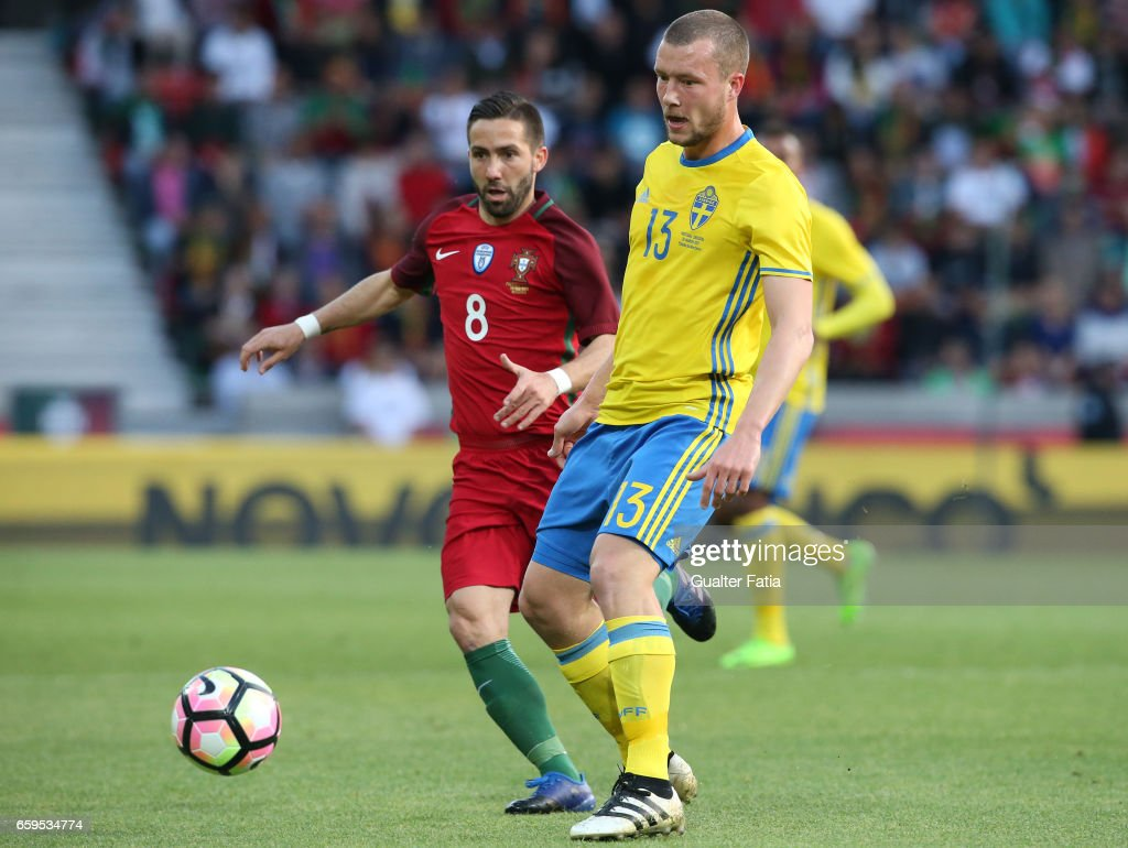 Sweden's defender Jakob Johansson with Portugal's midfielder Joao Moutinho in action during the International Friendly match between Portugal and Sweden at Estadio dos Barreiros on March 28, 2017 in Funchal (Madeira), Portugal.